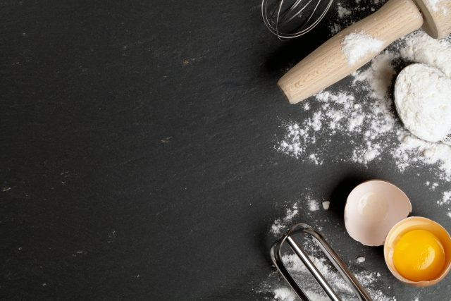 Recipe station with eggs, flour and rolling pin